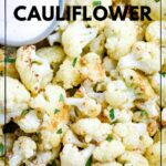 close up of cauliflower that has been air fried, next to sauce, topped with green garnish