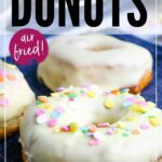 closeup of frosted donuts with sprinkles on blue napkin with graphic overlay
