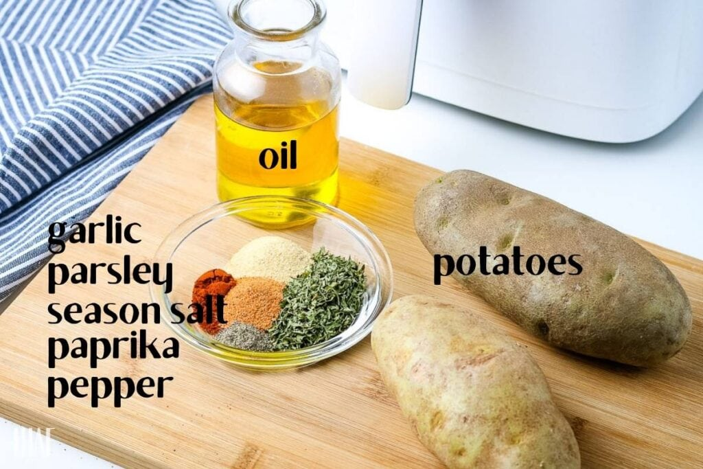 ingredients labeled on a cutting board for making diced potatoes in the air fryer