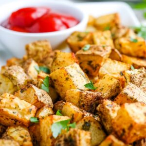 closeup of air fried diced potatoes with parsley garnish