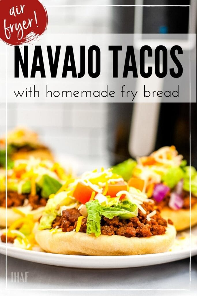 three indian fry bread tacos on a white plate with text overlay