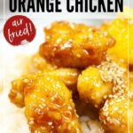 A picture of the Orange Chicken cooked on a bed of rice