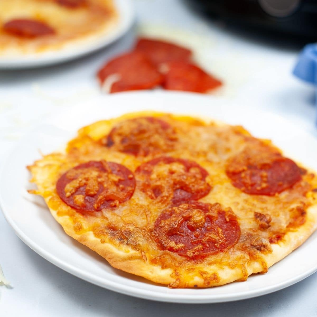 close up of individual naan bread pepperoni pizza made in the air fryer