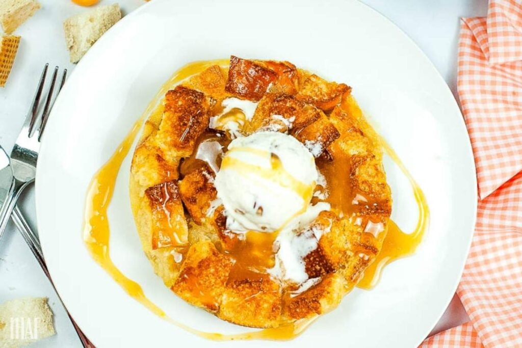 top shot of air fryer bread pudding with a scoop of vanilla ice cream
