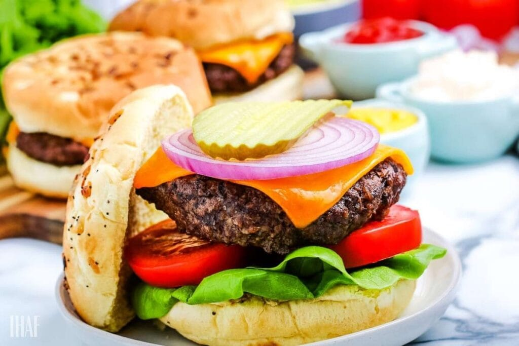 air fryer hamburger patty on a bun with toppings